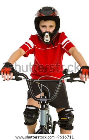 Young boy in helmet and protection kit sitting on BMX and looking at camera. Front view. White background. - stock photo