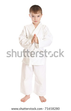 Young boy in kimono over pure white background - stock photo