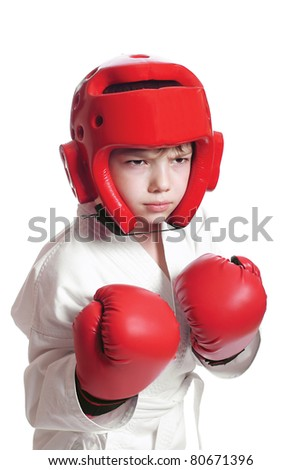 Young boy in kimono ready to fight on pure white background - stock photo