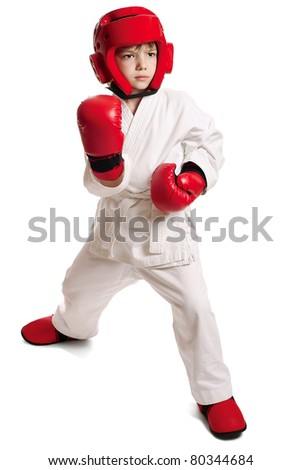 Young boy in kimono ready to fight over pure white background - stock photo