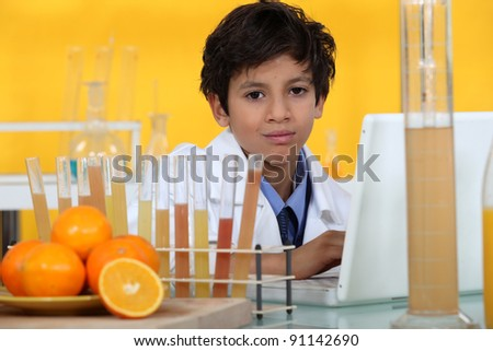 Young boy in laboratory - stock photo