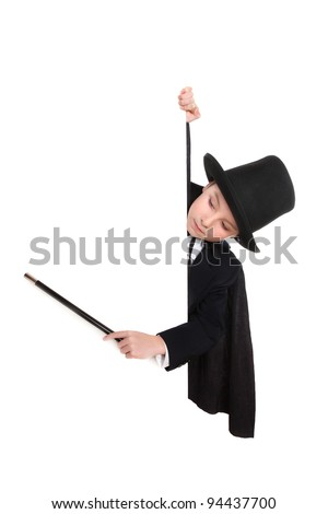 Young boy in magician costume point at a sign with his wand - stock photo