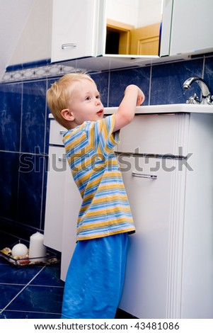 young boy in pyjamas in the bathroom