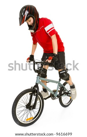 Young boy in red T-shirt cycling on BMX. He's maintain equilibrium. Isolated on white background. - stock photo