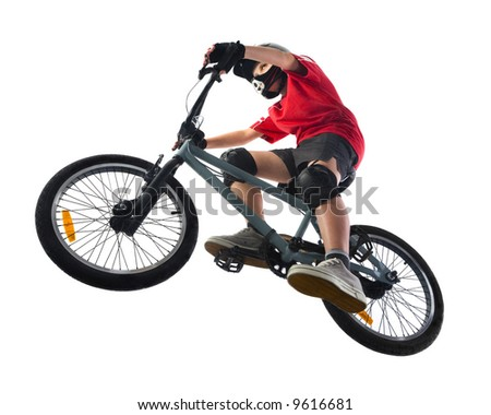 Young boy in red T-shirt cycling on BMX. Unusual angle view - directly below. - stock photo