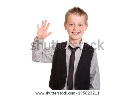 Young Boy in shirt and tie smiling and waving at the camera - stock photo