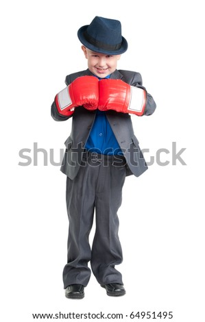 Young boy in suit and boxing gloves