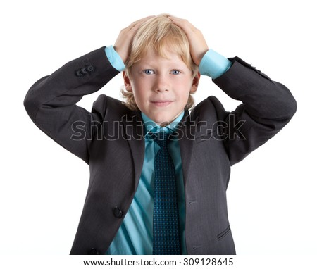 Young boy in suit clasped his head, looking at camera, isolated on white background - stock photo
