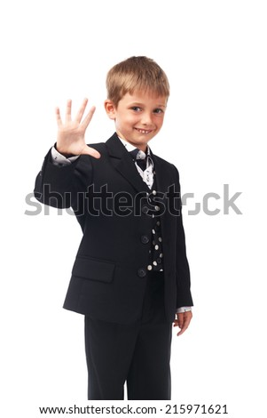 Young boy in the black suit showing five fingers isolated on white