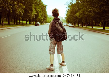 young boy in the street - stock photo
