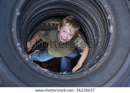 Young boy in tires at park