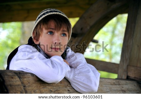 Young boy in traditional estonian clothes - stock photo