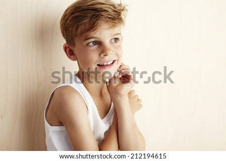 Young boy in vest looking away  - stock photo