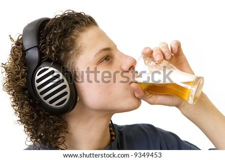 Young boy is drinking and listening - stock photo