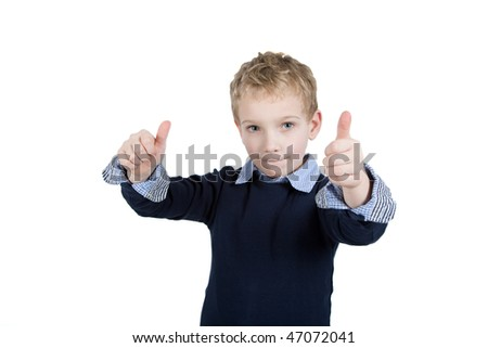 Young boy is holding his thumbs up. - stock photo