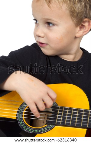 Young boy is playing on the guitar on a white background. - stock photo