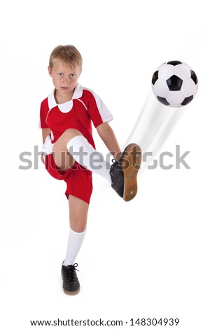 young boy is playing soccer, kid shoots a soccer ball isolated on white
