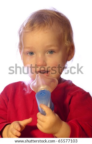young boy is using a inhalator