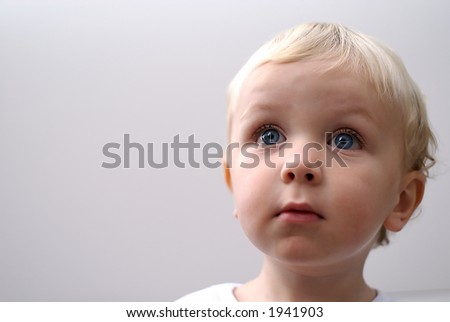 young boy isolated against white - stock photo