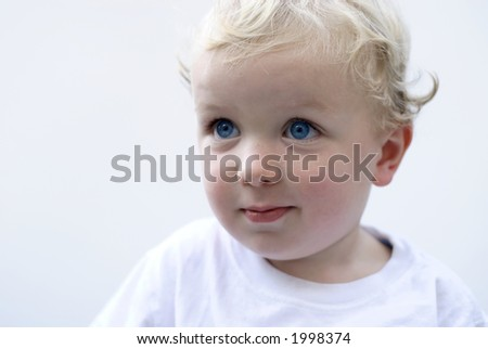 Young boy isolated on white background smiling - stock photo