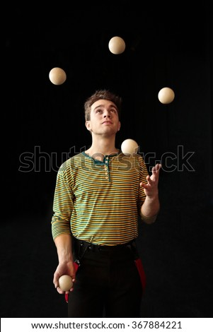 Young boy juggling - stock photo