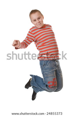 Young boy jumping isolated on a white background