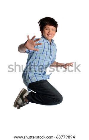Young boy jumping isolated over white background - stock photo