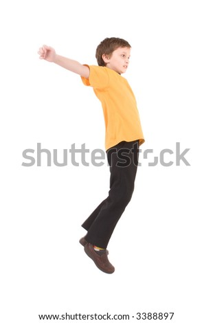 Young boy jumping up isolated on white - stock photo