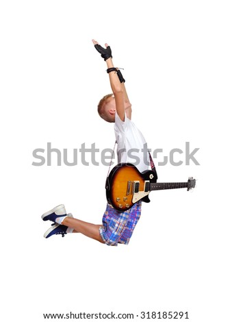 young boy jumping with guitar - stock photo