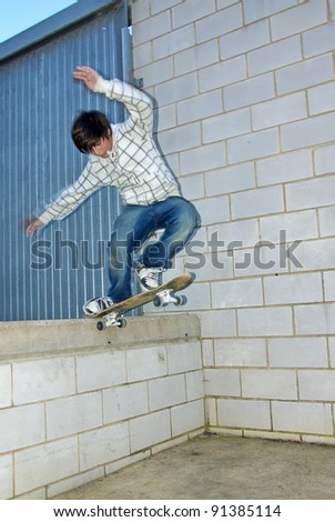 Young boy jumping with the skateboard - stock photo