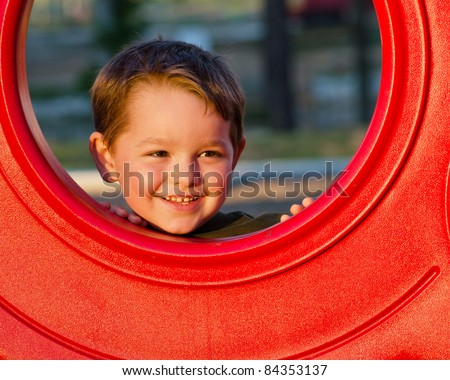 Young boy, kid or child playing outdoors on playground. - stock photo