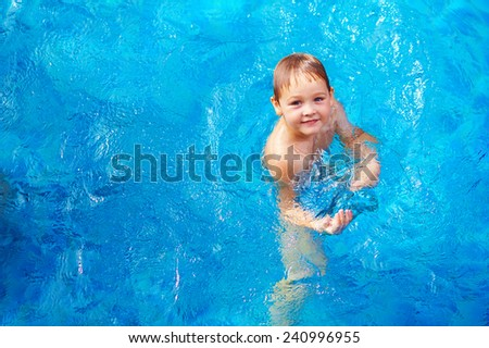 young boy kid swimming in pool - stock photo
