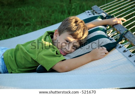 Young Boy Laying on a Hammock