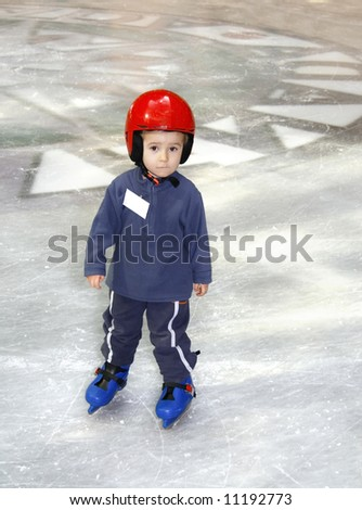 Young boy learning to skate - stock photo