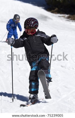 young boy learning to ski - stock photo