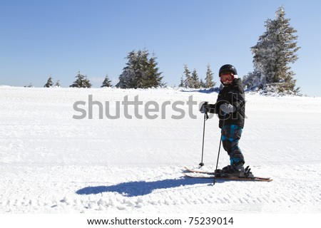 young boy learning to ski