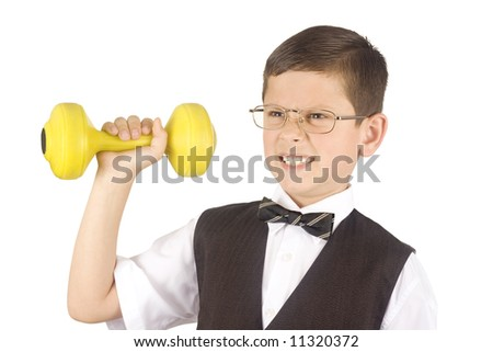 Young boy lifting weights isolated on white background - stock photo
