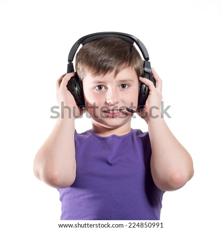 young boy listening a music in a headphones, isolated on white background