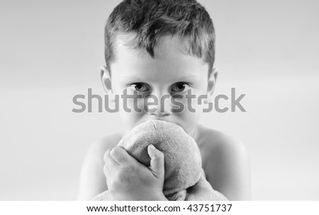 Young boy looking concerned or scared - stock photo