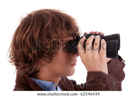 Young boy looking through binoculars, isolated on white, studio shot - stock photo