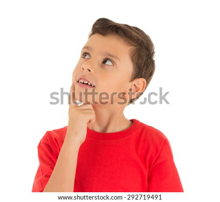 Young Boy looking up and thinking - stock photo