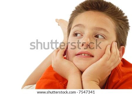 Young boy looking up in wonder - stock photo