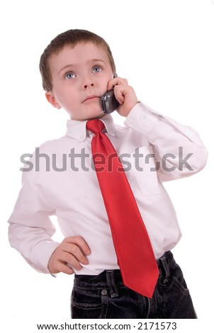 young boy making a business call on a cell phone on a white background - stock photo