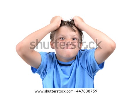 young boy making a silly face and grabbing hair