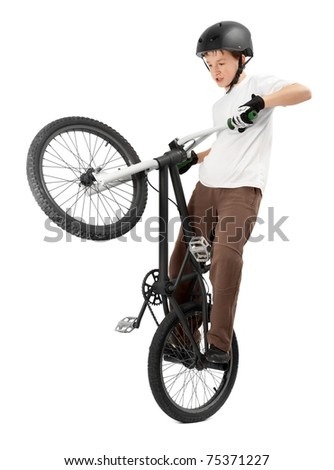 Young Boy making Tricks on Bike - stock photo