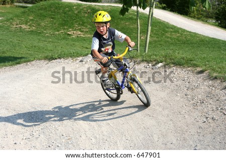 Young boy on a BMX track - stock photo