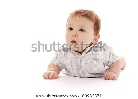 Young boy on a white background in a shirt