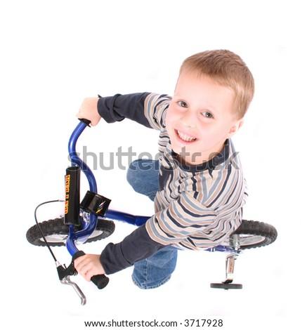young boy on bike - stock photo