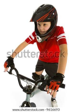 Young boy on bike and concentrated before cycling. Front wiev. White background. - stock photo