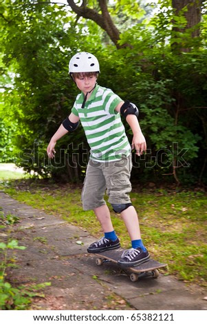 young boy on his skate board - stock photo